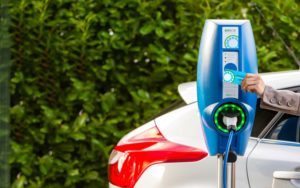 Man buying electric charging for his car