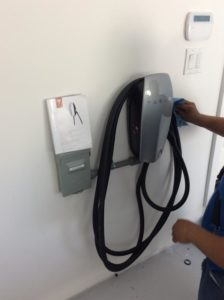 Electrician installing electric charger